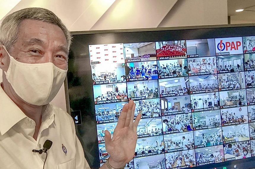 """Prime Minister Lee Hsien Loong taking a """"screen-wefie"""" with People's Action Party cadres yesterday. He said in his Facebook post: """"Found a way to meet everyone - virtually! I took a screen-wefie with our PAP comrades who were tuning in from their res"""