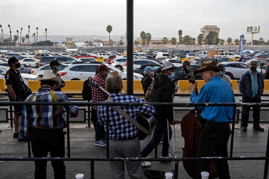 Commuters queuing at San Ysidro crossing port on the US-Mexico border in Tijuana, Baja California state, Mexico, on Oct 6, 2020.