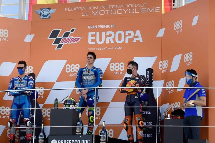 Winner Joan Mir celebrating on the podium with Suzuki teammate Alex Rins (second) and KTM's Pol Espargaro after the European Grand Prix in Valencia on Nov 8, 2020.