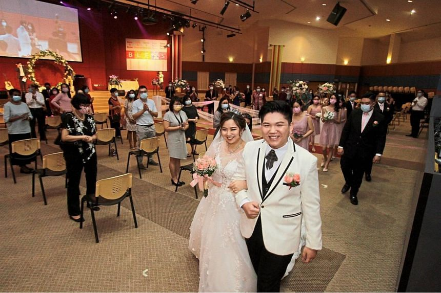 Ms Joy Ong and Mr Kelvin Looi tying the knot at the Penang Christian Centre in George Town.
