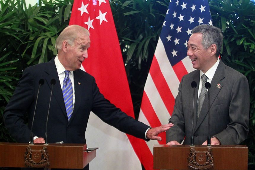 Joe Biden (left) and Prime Minister Lee Hsien Loong seen during a press conference at the Istana on July 26, 2013.