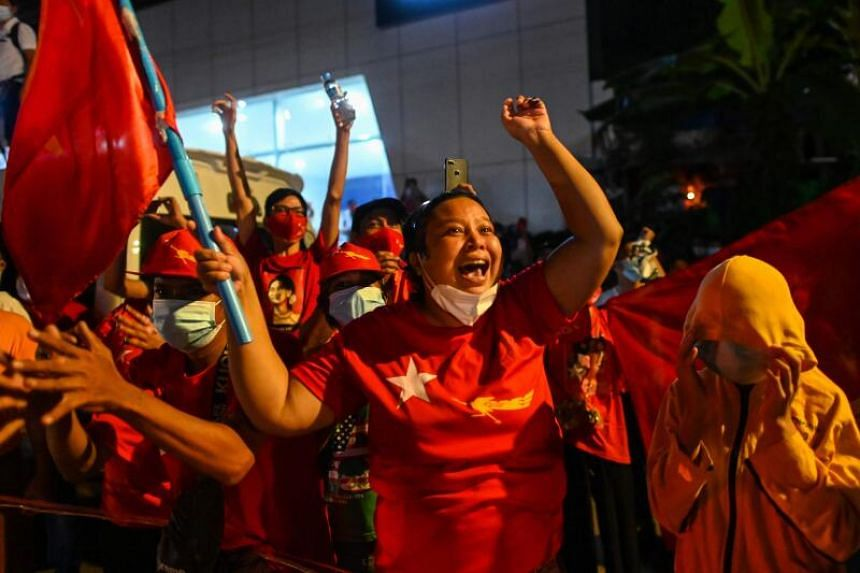 Supporters of the National League for Democracy party react in front of the party's headquarters in Yangon, Myanmar, on Nov 8, 2020.