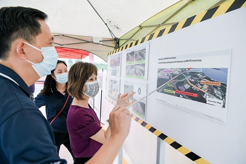 Senior Minister of State for Transport and Sustainability and the Environment Amy Khor getting an overview of the expansion of the interchange between the KPE and TPE from Land Transport Authority senior project manager Wong Fook Chee yesterday. PHOT