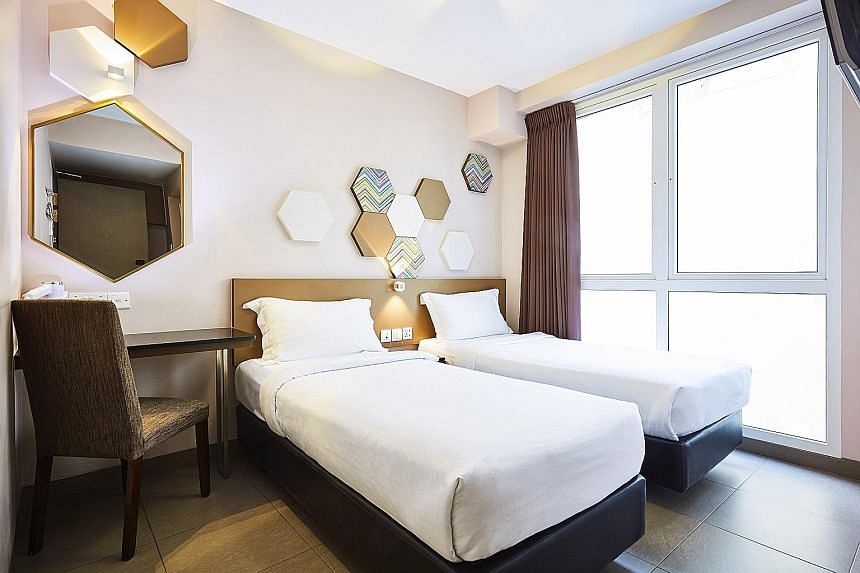 Neutral cream and beige tones dominate the rooms (left) in the new Ibis Budget Singapore Imperial in Lavender.