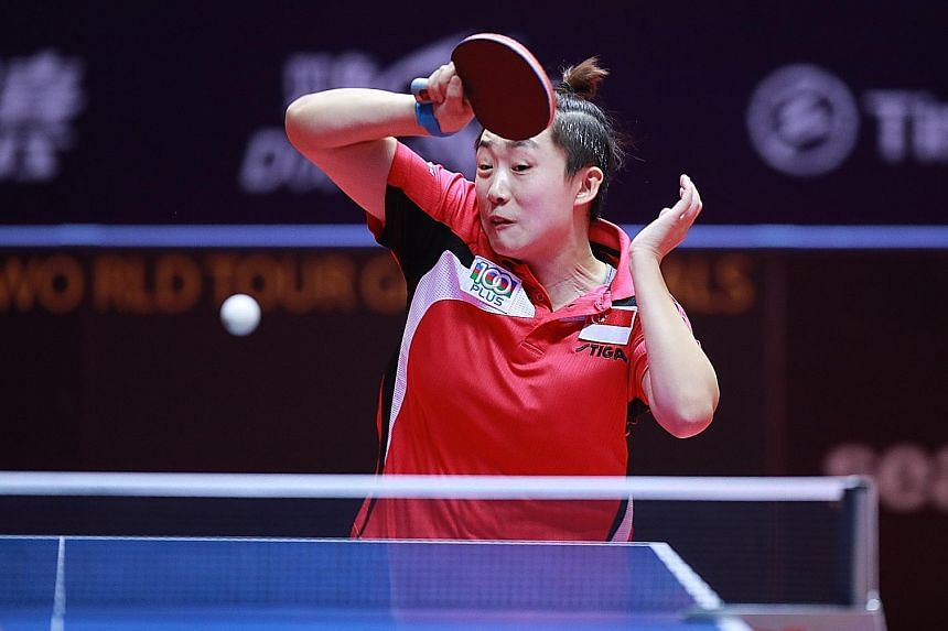 Singapore paddler Feng Tianwei (left) was beaten 4-2 by Lily Zhang in the round of 16 at the ITTF Women's World Cup in China. Feng had defeated the American in the bronze medal match at the same tournament last year.