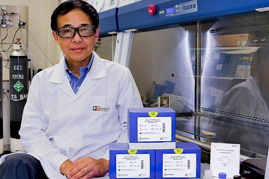 Professor Wang Linfa, director of Duke-NUS Medical School's emerging infectious diseases programme, with the cPass test kit. He led the team that invented cPass, which detects whether someone has antibodies that neutralise the coronavirus. PHOTO: DUK