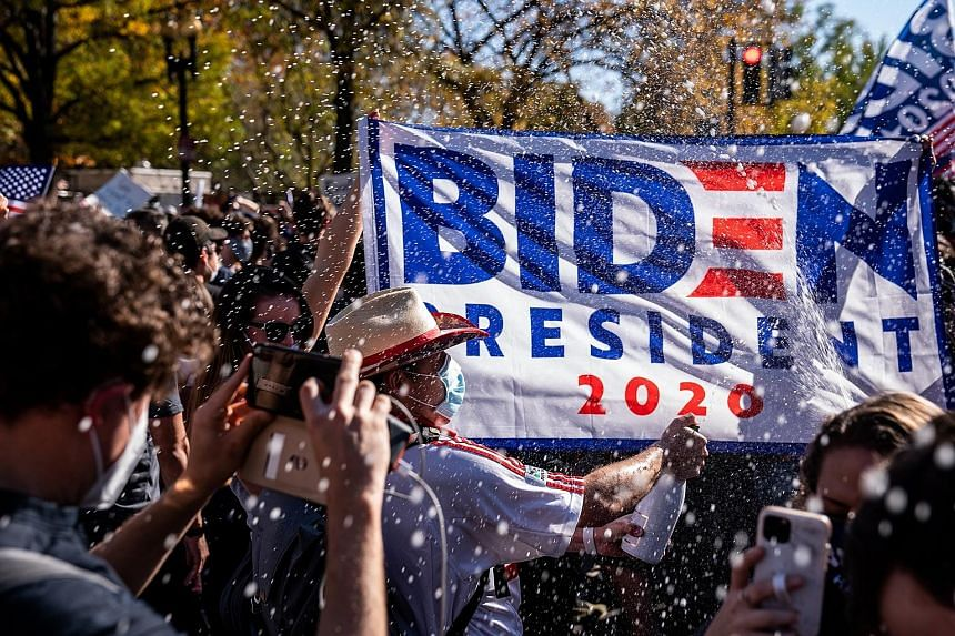 "People celebrating in Washington after news organisations announced that Mr Joe Biden had won the US presidential election last Saturday. President Donald Trump may have been cruel to call him ""Sleepy Joe"". Yet a ""Sleepy Joe"" and calm American presid"