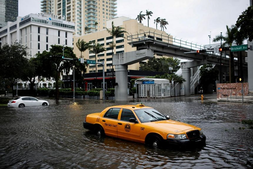 Neighbourhoods flooded across several parts of South Florida, including Miami's Brickell Avenue financial district.