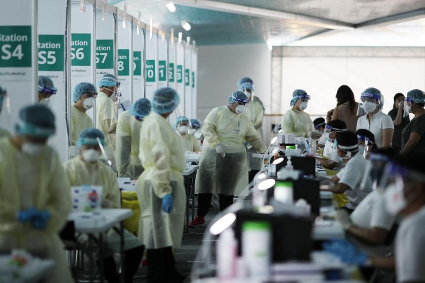 Covid-19 swab testing for people before boarding the World Dream cruise ship at Marina Bay Cruise Centre on Nov 6, 2020.