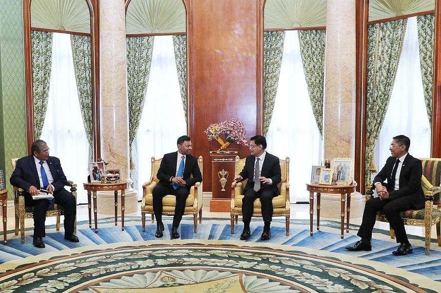 DPM Heng Swee Keat (centre right) also called on Brunei Crown Prince Al-Muhtadee Billah (centre left), along with Dr Maliki Osman (right), on Nov 10, 2020.