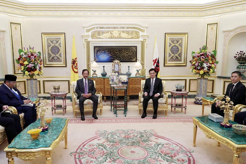 Singapore DPM Heng Swee Keat (centre right) meeting with Brunei's Sultan Hassanal Bolkiah (centre left), along with Minister in the Prime Minister's Office Maliki Osman (right) on Nov 10, 2020.
