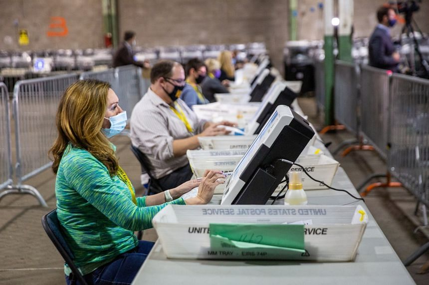 Poll workers tabulate ballots at the Allegheny County Election Warehouse in Pittsburgh, Pennsylvania, on Nov 6, 2020.