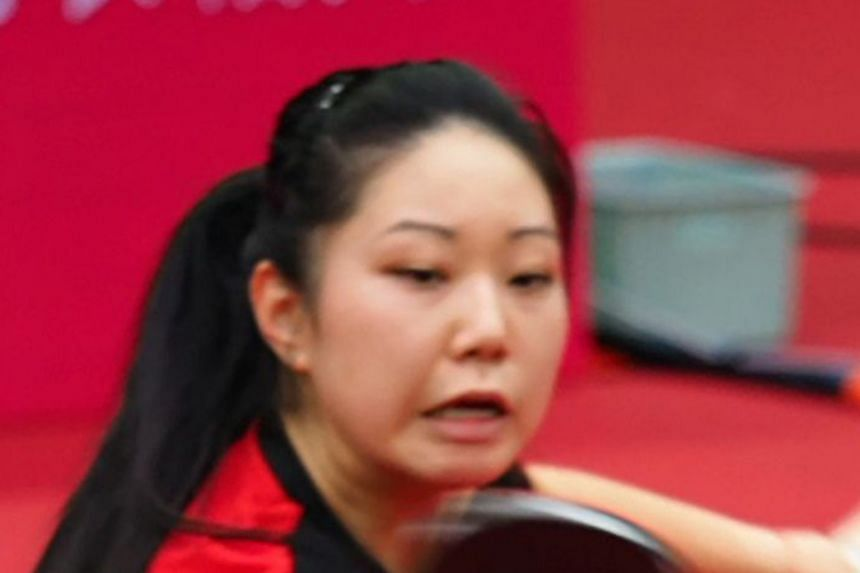 Singapore paddler Feng Tianwei was beaten 4-2 by Lily Zhang (above) in the round of 16 at the ITTF Women's World Cup in China. Feng had defeated the American in the bronze medal match at the same tournament last year.