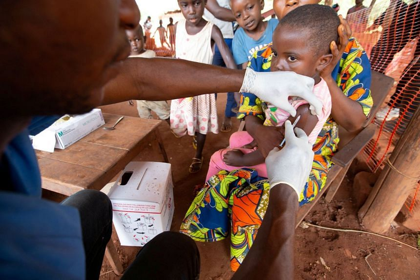 A child is given a measles vaccination during a campaign run by Doctors Without Borders in the Democratic Republic of Congo.