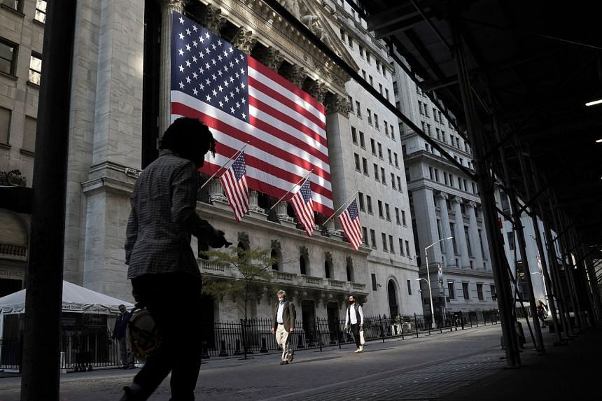 A person walks past the New York Stock Exchange in  New York City, Nov 10, 2020.