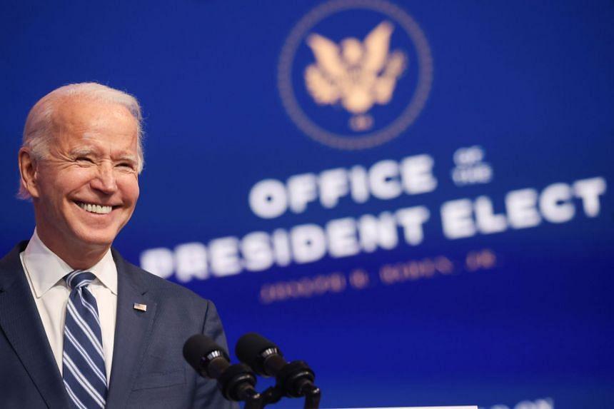 Biden smiles as he talks at an event in Wilmington, Delaware, Nov 10, 2020.