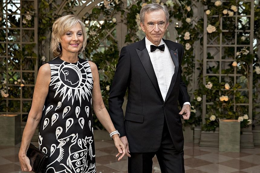 Mr Bernard Arnault and his wife Helene in a 2018 photo. PHOTO: BLOOMBERG The first four centibillionaires with fortunes exceeding US$100 billion are (from left) Mr Jeff Bezos, Mr Elon Musk, Mr Bill Gates and Mr Mark Zuckerberg