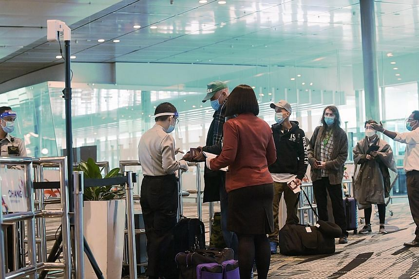 Travellers queueing to enter a transit holding area at Changi Airport. Education Minister Lawrence Wong said Singapore is keen on discussing air travel bubbles with places that have a similar Covid-19 incidence rate as Singapore, or are safe and low-