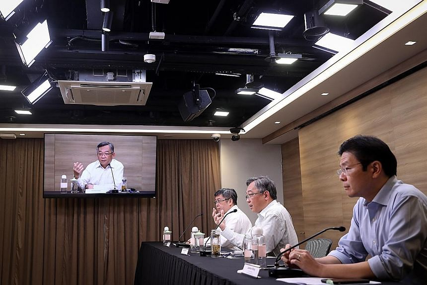 Health Minister Gan Kim Yong (centre), Education Minister Lawrence Wong (right) and Associate Professor Kenneth Mak at a briefing on the Covid-19 situation yesterday. Mr Gan said that even when vaccines become available, they will have to be given ou
