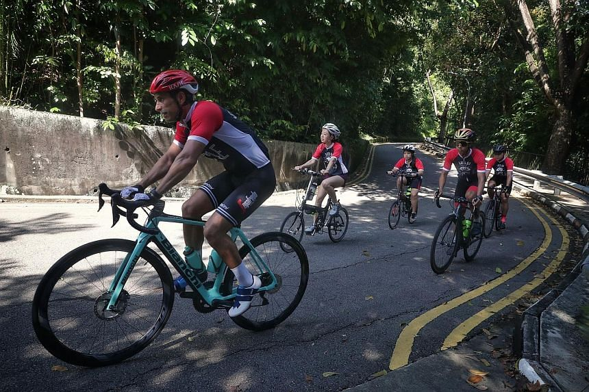 (From left) Adrian Staiti, 45, Adalia Quek, 35, Tan Hui Er, 24, Juan Miguel Ramos Ocampo, 31, and Aylwin Rory Tenorio, 47, are part of a team from Sportfive who will participate in the OCBC Cycle 2020 The Sportive Virtual Ride by cycling the equivale