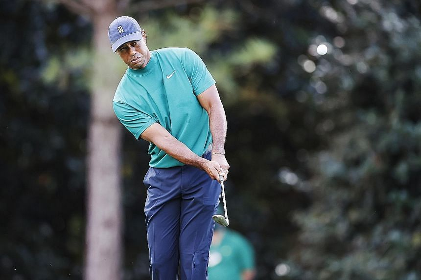 Tiger Woods playing a shot during a practice round on Monday before the start of the Masters tomorrow. The 15-time Major champion needs three more Majors to tie Jack Nicklaus' record of 18.