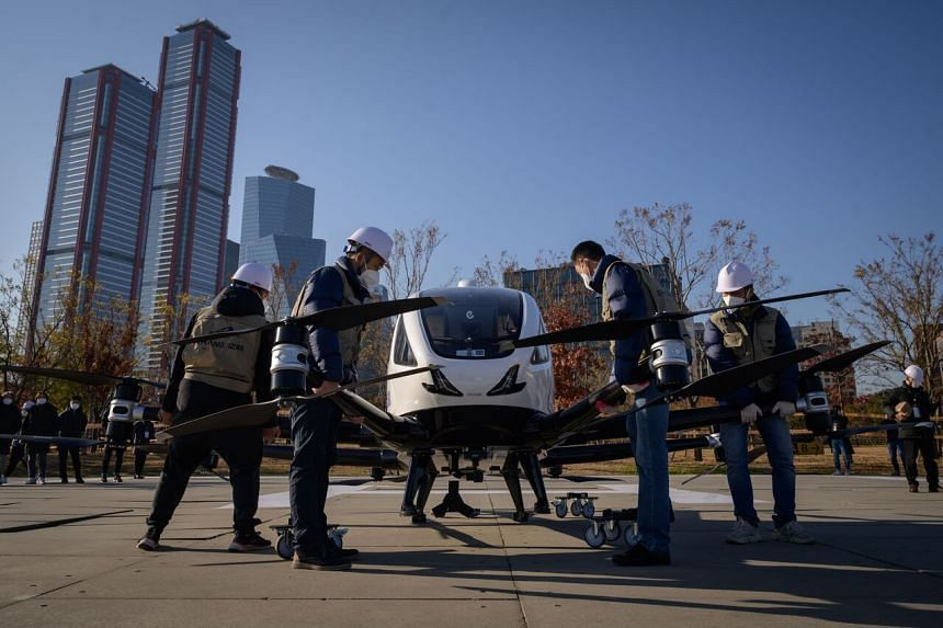 Ehang staff preparing a two-passenger multicopter aircraft for an unmanned display flight, in Yeouido, Seoul, on Nov 11, 2020.