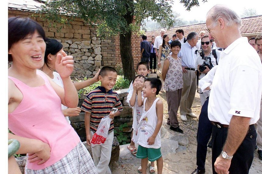 Then US Senate Foreign Relations Committee chairman Joe Biden (right) joking with villagers in Yanzikou, on Aug 10, 2001.