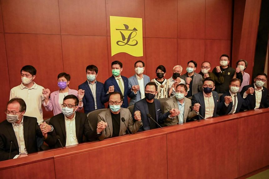 Hong Kong's 19 opposition lawmakers had earlier threatened a mass resignation should any of them be disqualified from the Legislative Council.