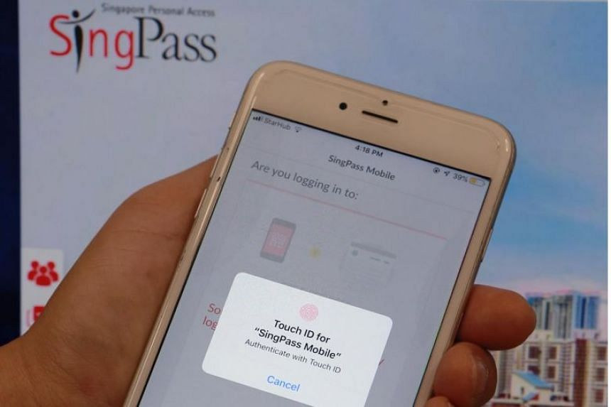Users call up the SingPass Mobile app on their phone and launch the scan function to scan the QR code to initiate a signing request.
