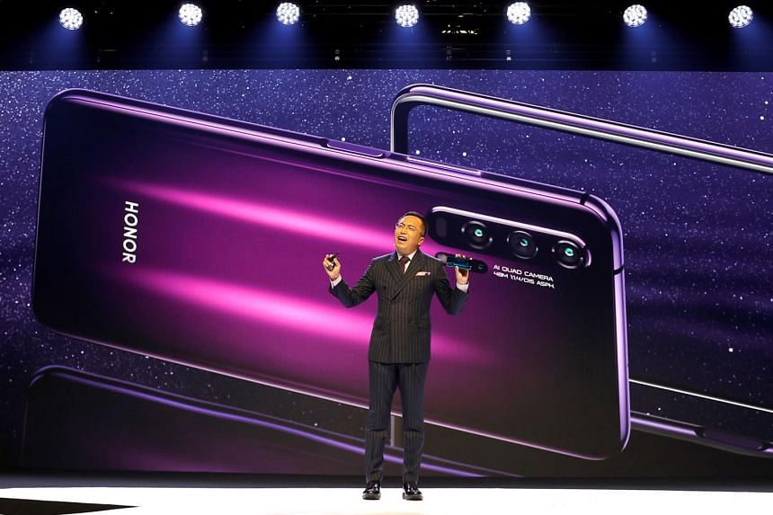 In a photo from May 21, 2019, Honor President George Zhao launches the Honor 20 range of smartphones at an event in London.