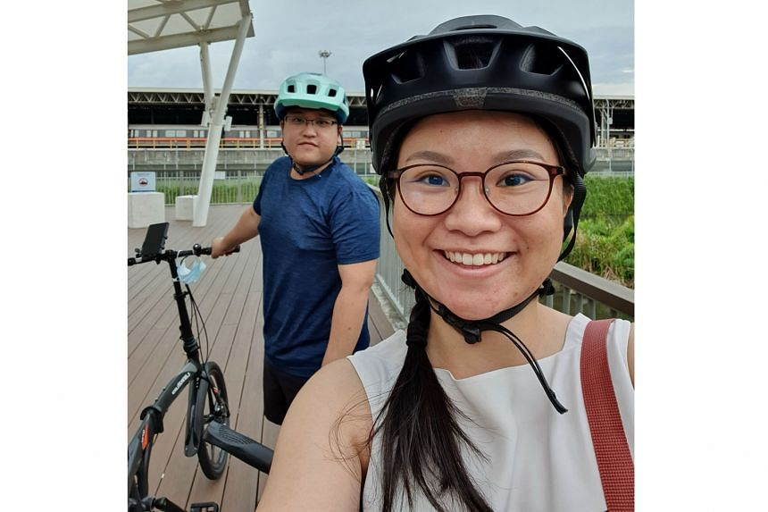 (Right) Ms Phua Sin Hui and her fiance Benjamin Khew at the park connector along Bishan Depot.