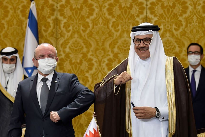 Bahrain Foreign Minister Abdullatif bin Rashid Al-Zayani (right) and head of the Israeli delegation, National Security Advisor Meir Ben Shabbat, bump elbows after a signing ceremony in Manama on Oct 18, 2020.