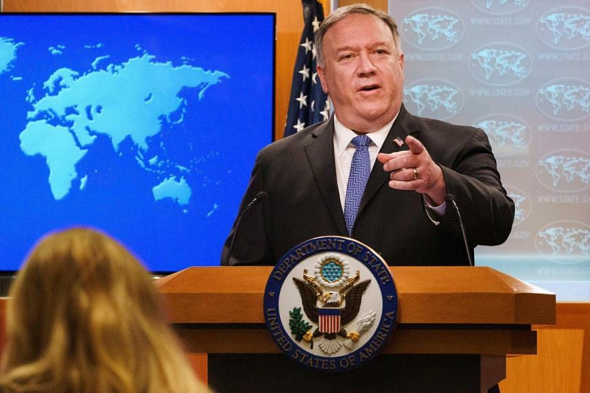 Pompeo gestures towards a reporter while speaking about the counting of votes in the US election.