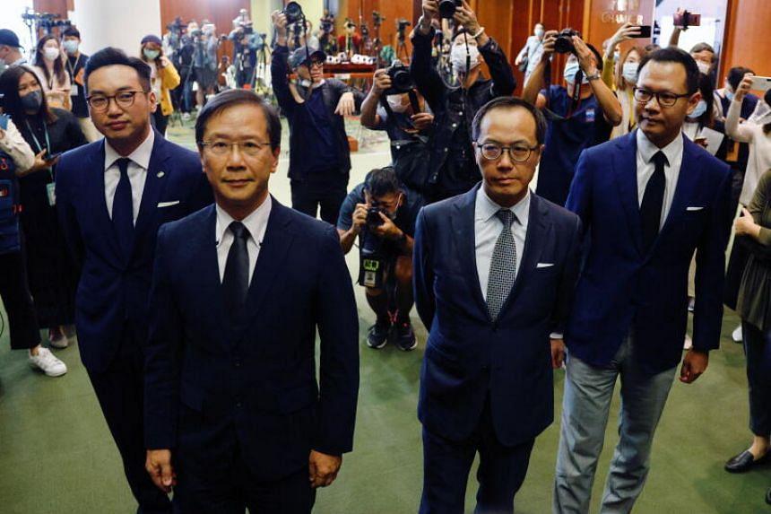 Former pan-democratic legislators Alvin Yeung, Kwok Ka Ki, Kenneth Leung and Dennis Kwok speak to the media in Hong Kong, on Nov 11, 2020.