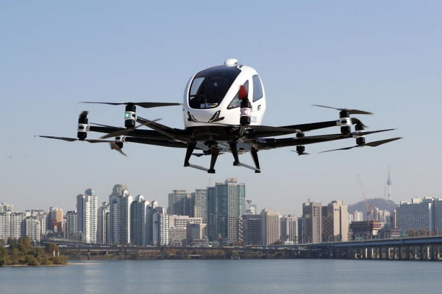 The EH216 drone taxi made by Chinese firm Ehang flying during a test in Yeouido, Seoul, on Nov 11, 2020.