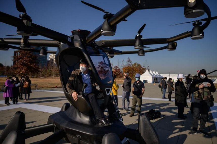 A visitor sitting in a Hexa all-electric VTOL aircraft, at an event showcasing a drone traffic management system, in Yeouido, Seoul, on Nov 11, 2020.