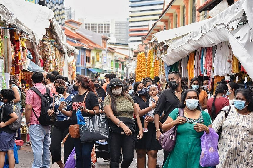 Shoppers in Campbell Lane on Nov 1. There have been smaller crowds in Little India compared with during the festive period in previous years, but business appeared brisk at various shops over the past two weekends.