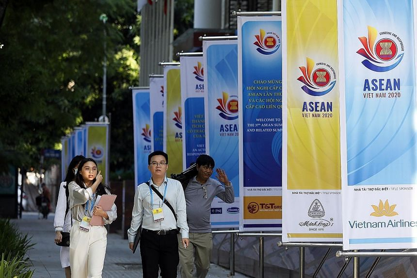 Banners promoting this week's Asean Summit line the street in Hanoi, Vietnam. Regional leaders will meet virtually and focus on an agenda that includes the completion of the Regional Comprehensive Economic Partnership deal and the launch of the regio