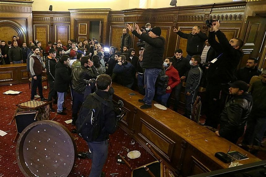 People storming the Government House in Yerevan, Armenia, on Tuesday, after Prime Minister Nikol Pashinyan said he had signed the Russian-brokered peace deal to end weeks of heavy fighting in Nagorno-Karabakh. PHOTO: REUTERS