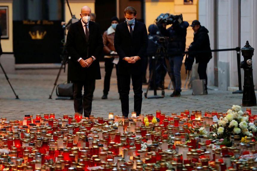 European Council President Charles Michel and Austrian Chancellor Sebastian Kurz attend a ceremony at the site of a gun attack in Vienna, Austria, on Nov 9, 2020.