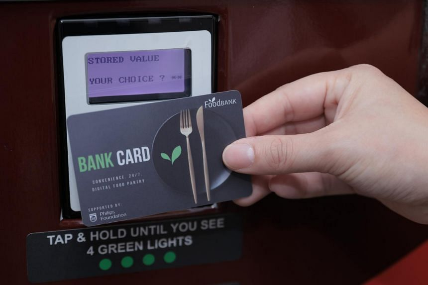 """The Food Bank has partnered Philips Foundation to distribute 45,000 """"bank cards"""" that individuals islandwide can use at the machines."""