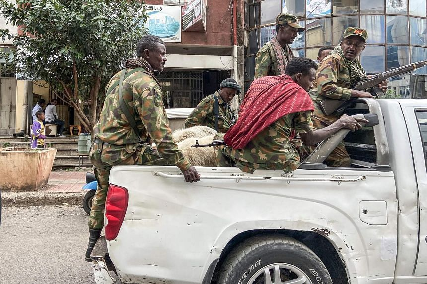 Amhara militiamen, who fight alongside federal forces, riding on the back of a pick-up truck in the city of Gondar, Ethiopia, on Nov 8, 2020.