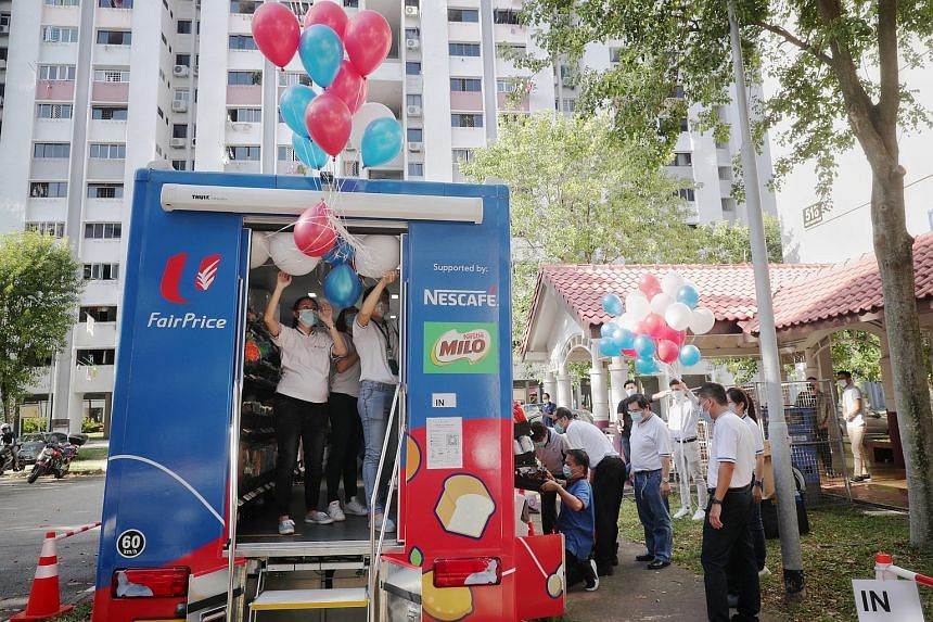 FairPrice staff preparing balloons for the launch of FairPrice on Wheels at block 518 West Coast Road, on Nov 12, 2020.