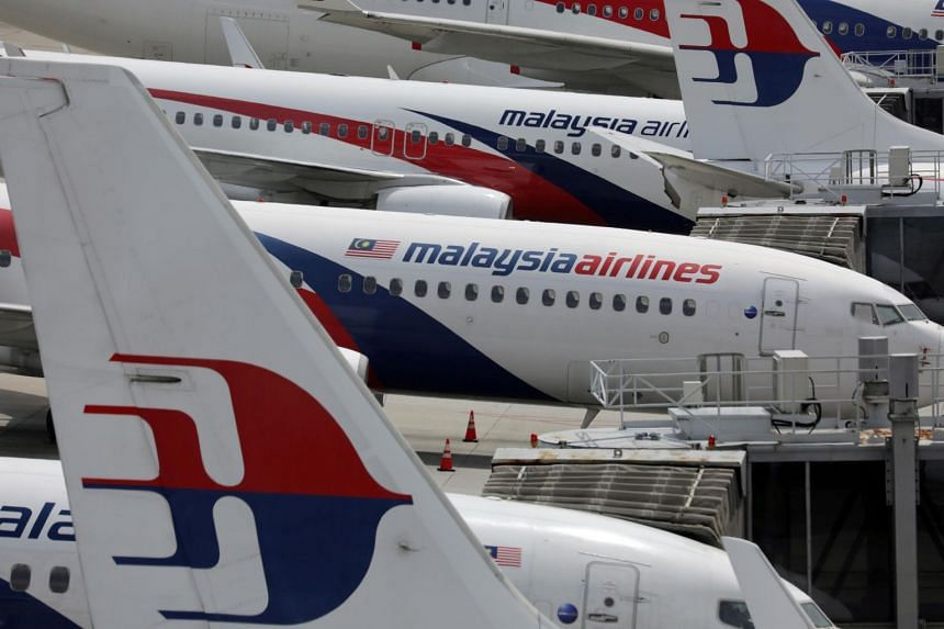 Malaysia Airlines have cut staff and announced restructuring plans.