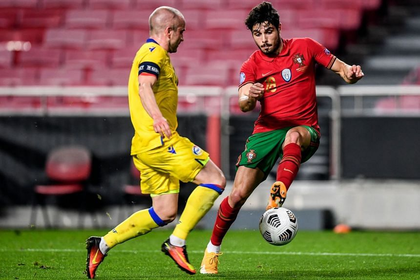 Andorra's midfielder Marc Pujol (left) vies with Portugal's Neto during the match.