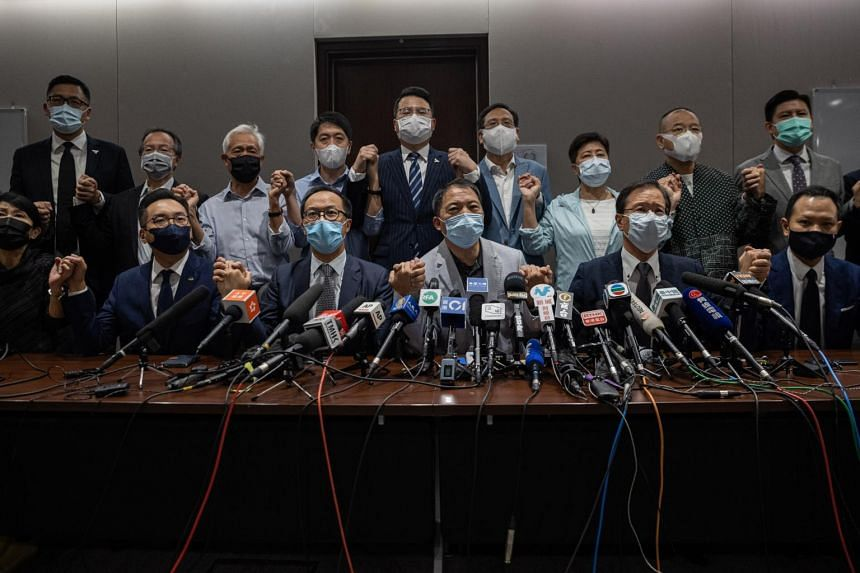 The 15 remaining opposition lawmakers have resigned en masse after four legislators were banished from the Legislative Council in Hong Kong.