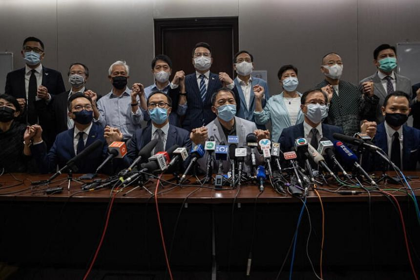 Pan-democratic lawmakers speaking to the press after their mass resignation from Hong Kong's Legislative Council, on Nov 11, 2020.