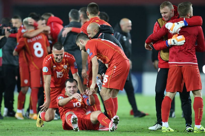 Goran Pandev celebrates with teammates after the match.