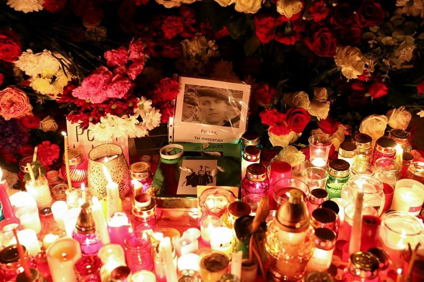 Flowers and candles left by people mourning the death of anti-government protester Roman Bondarenko, in Minsk, on Nov 12, 2020.