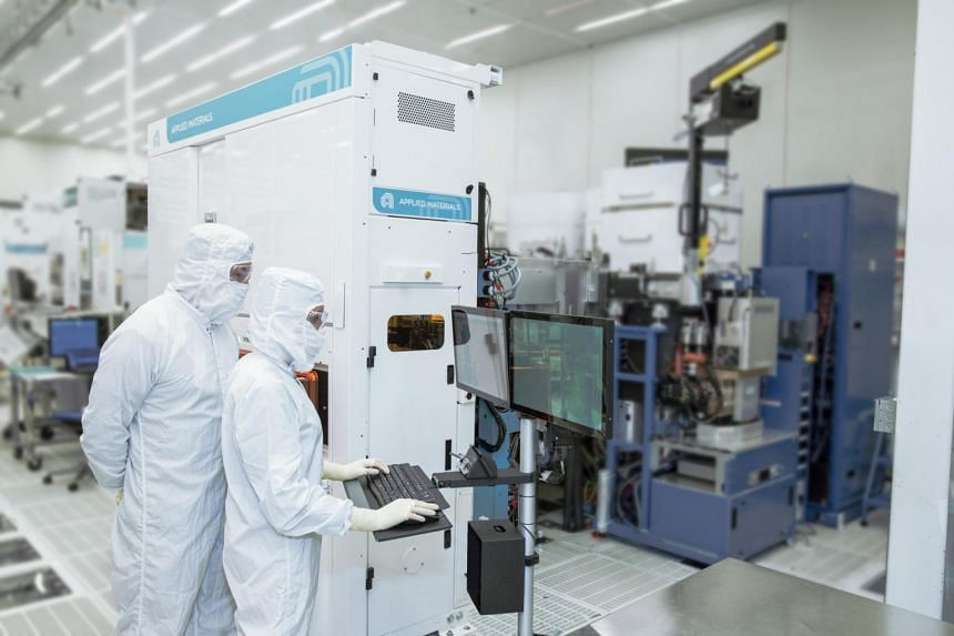 Applied Materials engineers work on the latest technology to help enable faster, more efficient microchips.